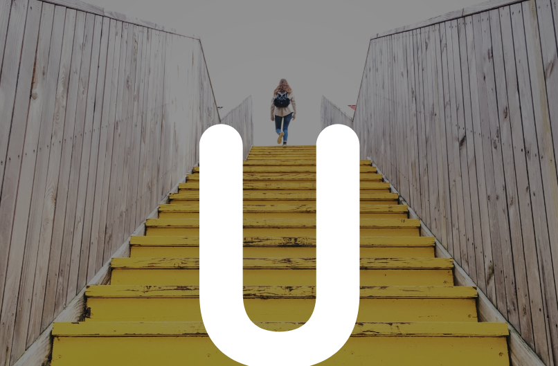 Woman walking up stairs with an overlay U